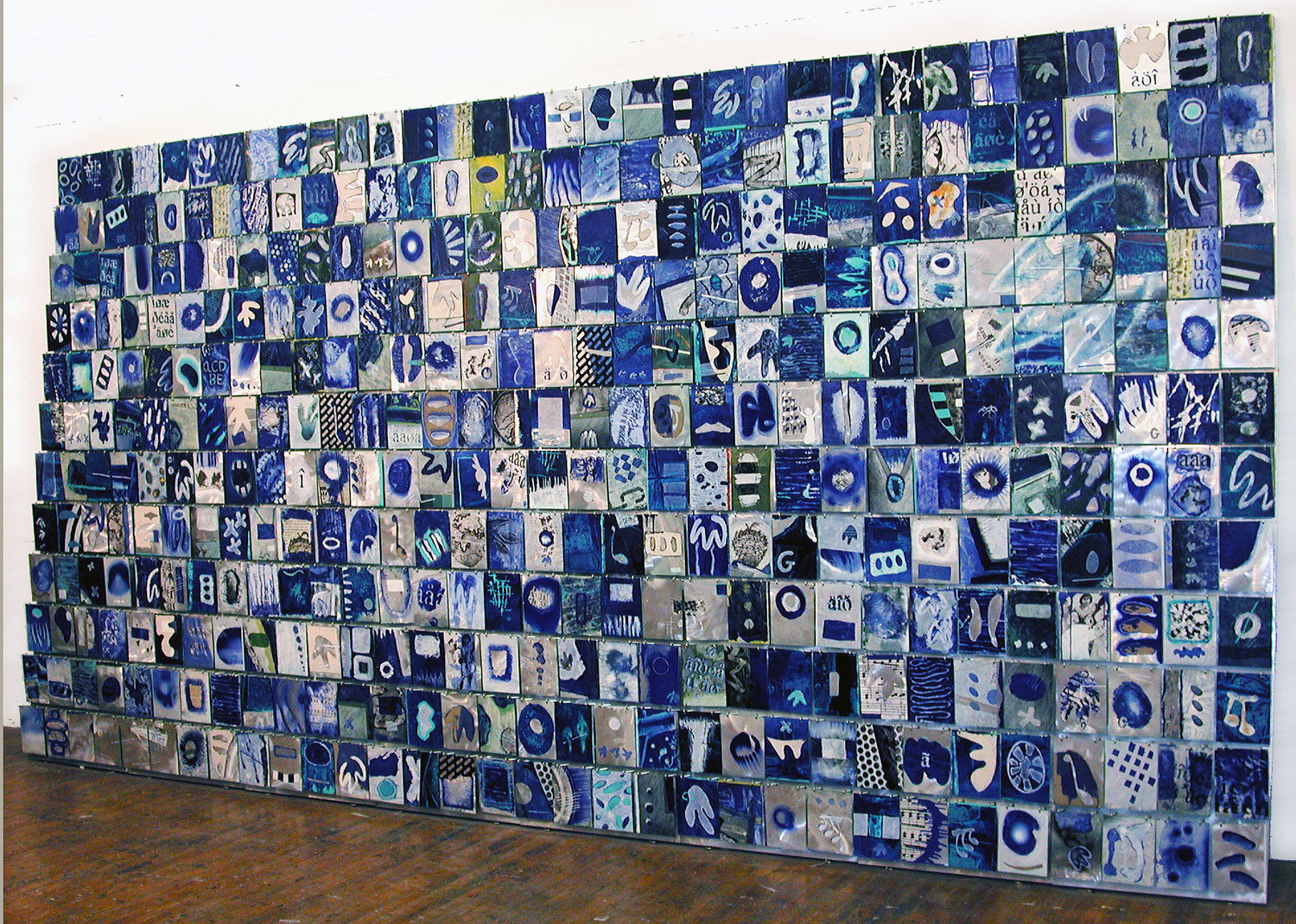 "Rhapsody in Blue    2001   Canvas, Paper, Alkyd, and Hooks on Aluminum  106"" x 184"" x 20""    (H-2)"
