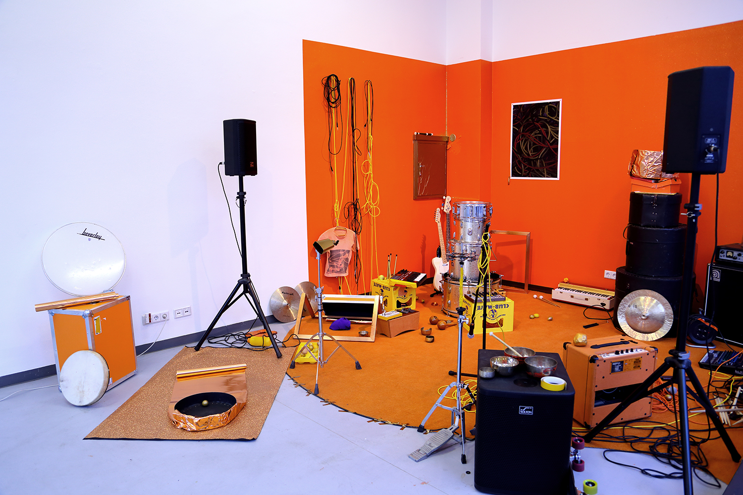 Mixed media     (installation view)  Galerie Wedding Raum für zeitgenössische Kunst , Berlin   Practice Room  is a spatial installation that is open to be used by visitors, guests/bands and the »flatmates«. They can convene and try out and play (with) altered instruments. Lucinda Dayhew invites us to collective rehearsals. A practice room is usually secluded, it is not a public space. Songs and melodies are not final, the musicians have no audience yet. Dayhew allows us to experience the processes of collective music making, the harmonies and disharmonies from inside the rehearsal space – accessible to the »flatmates«, visitors and people passing by. Over the course of the exhibition she invites different musicians to rehearse in her Practice Room. These rehearsals take place at different times during the day and night, they are visible and audible from the outside, but they are not public concerts. At the opening Dayhew's Band Luci Lippard will, however, rehearse six versions of  Still Life II  in public.  Text: Kathrin Pohlmann & Julia Zieger - curators of  Vacancies!  as part of  Post Otherness Wedding  - a series of exhibitions curated by Solvej Helweg Ovesen &Bonaventure Soh Bejeng Ndikung at Galerie Wedding