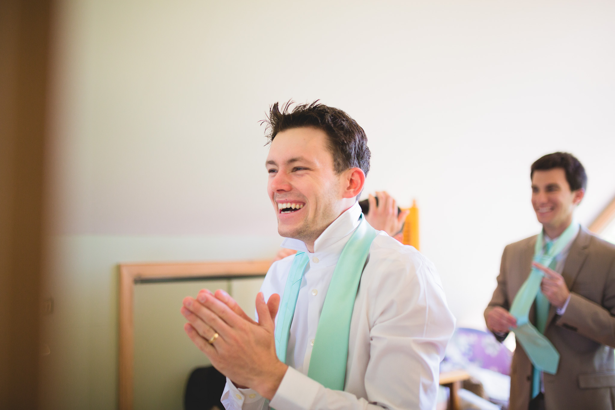 Groom-Getting-Ready-Laughing