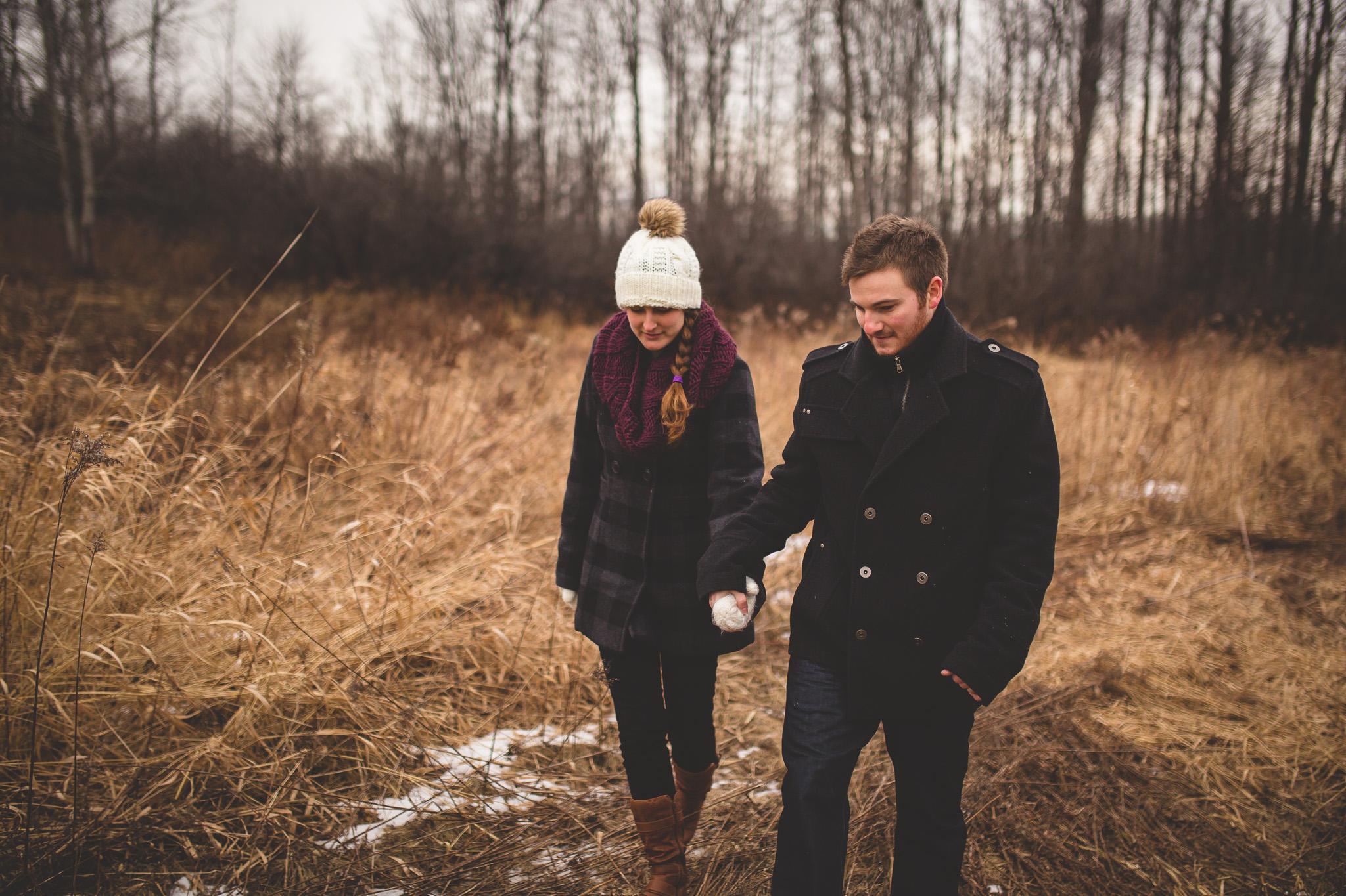 couple-walking-through-field-ottawa