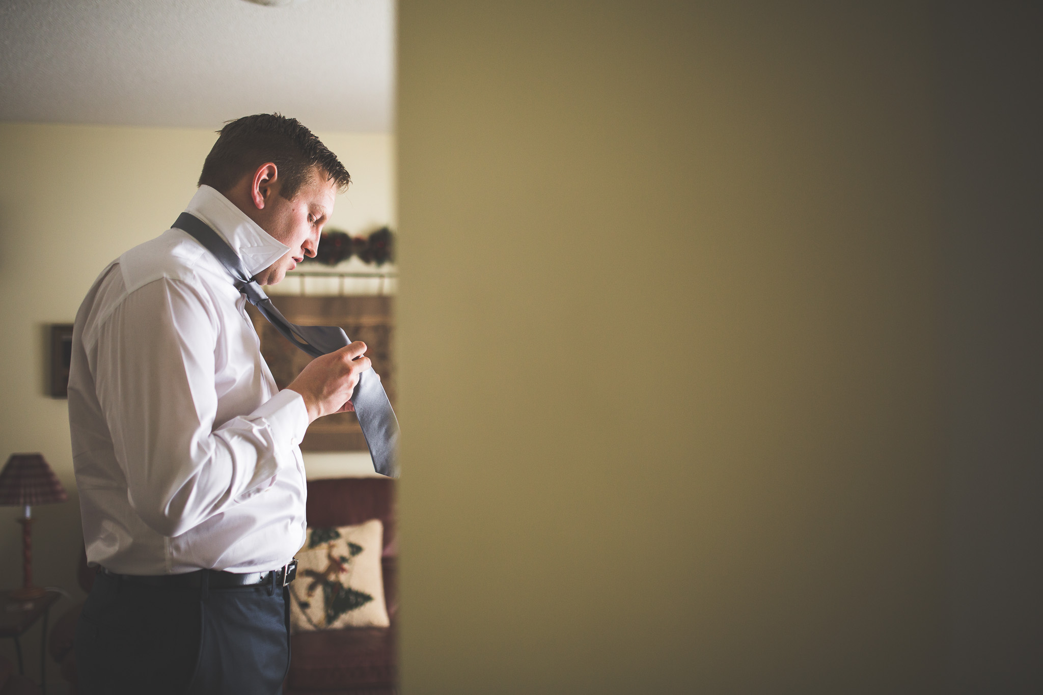 artistic-groom-getting-ready
