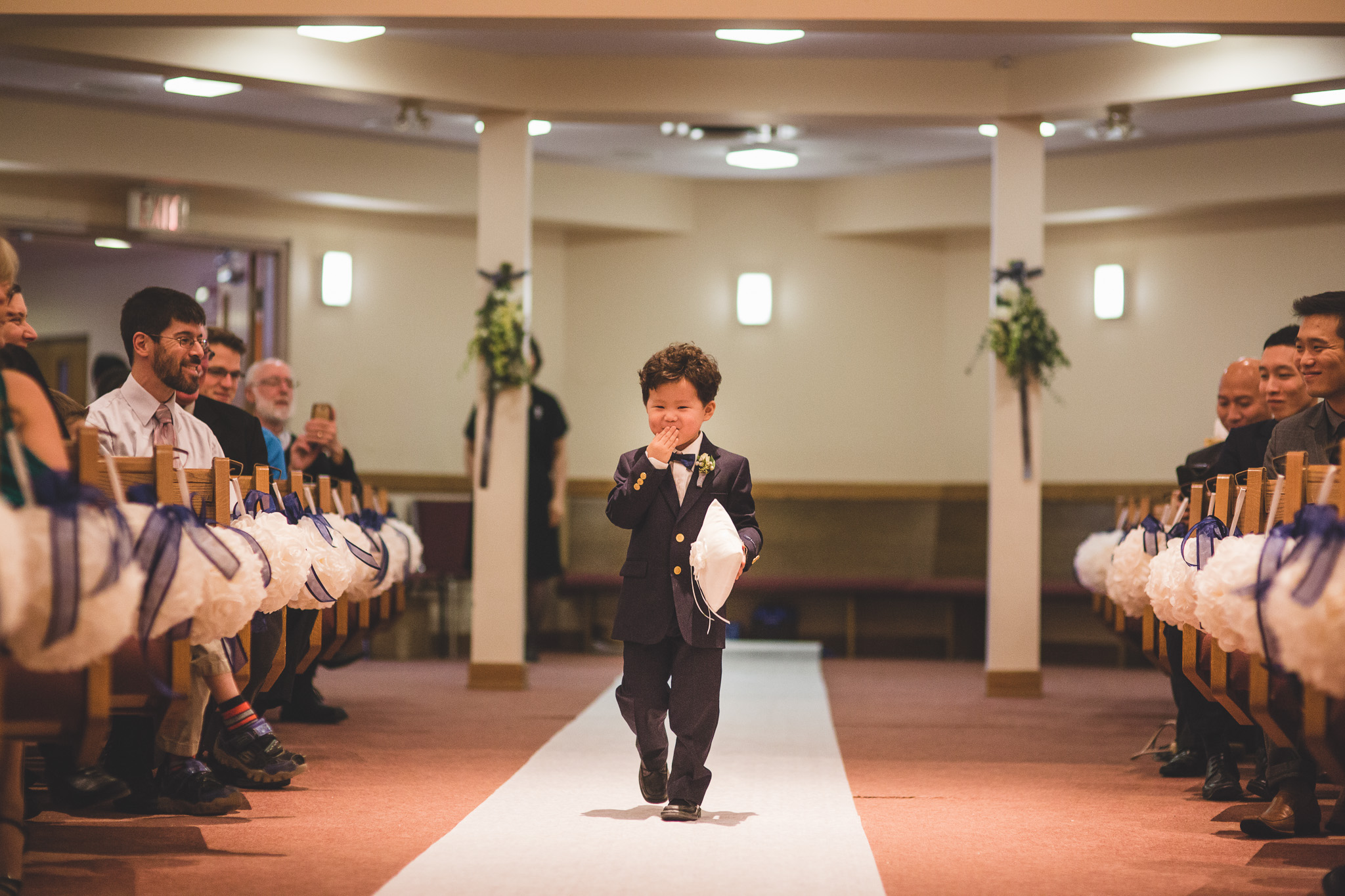 ring-bearer-blowing-kisses
