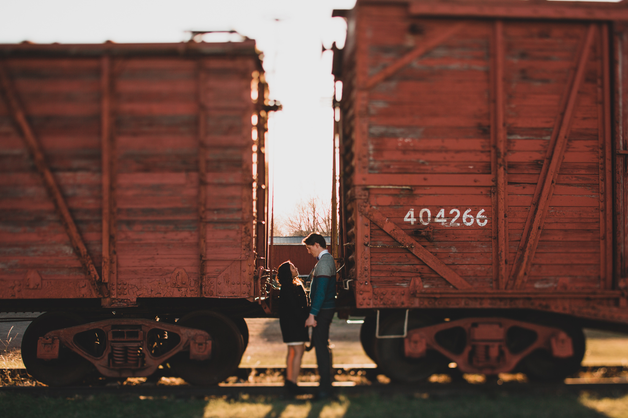 couple between train cars engagement photo location