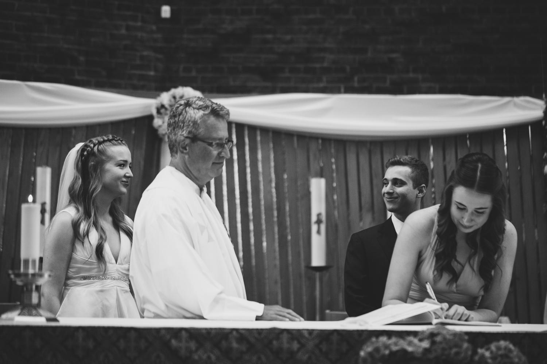 Bride & Groom sharing glances, wedding ceremony