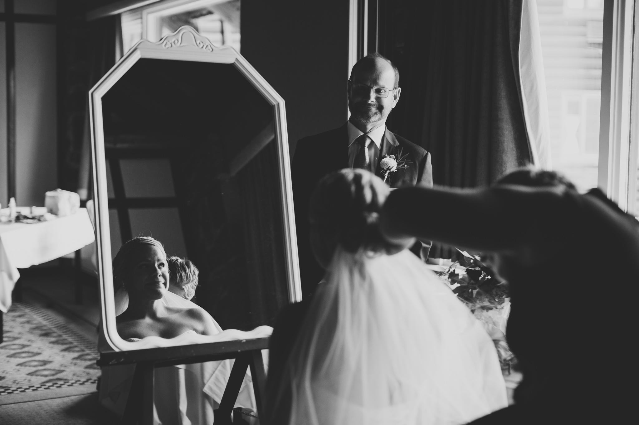 Father looking at daughter, wedding day moment