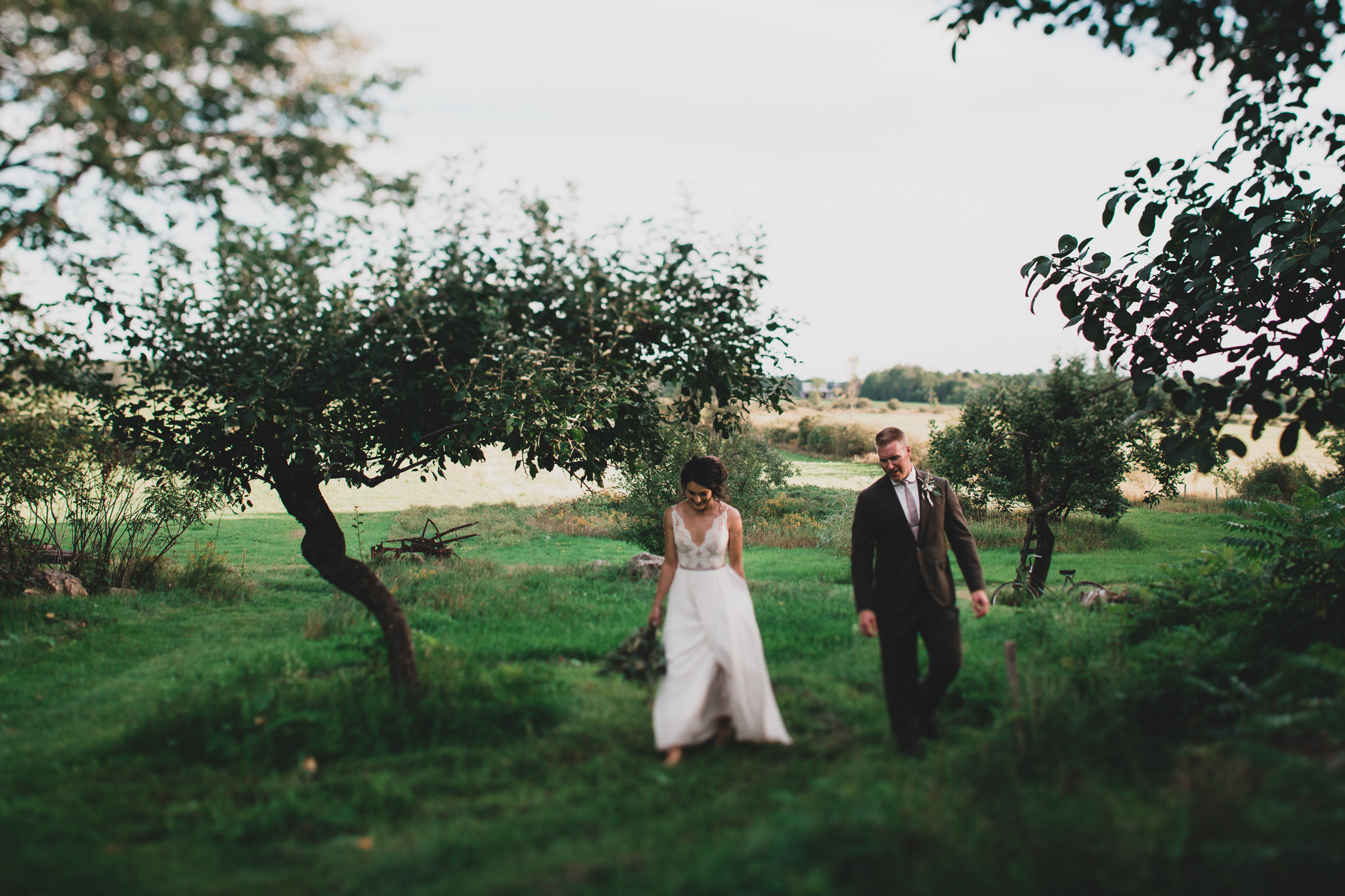Bride and groom walking candidly Jonathan Kuhn