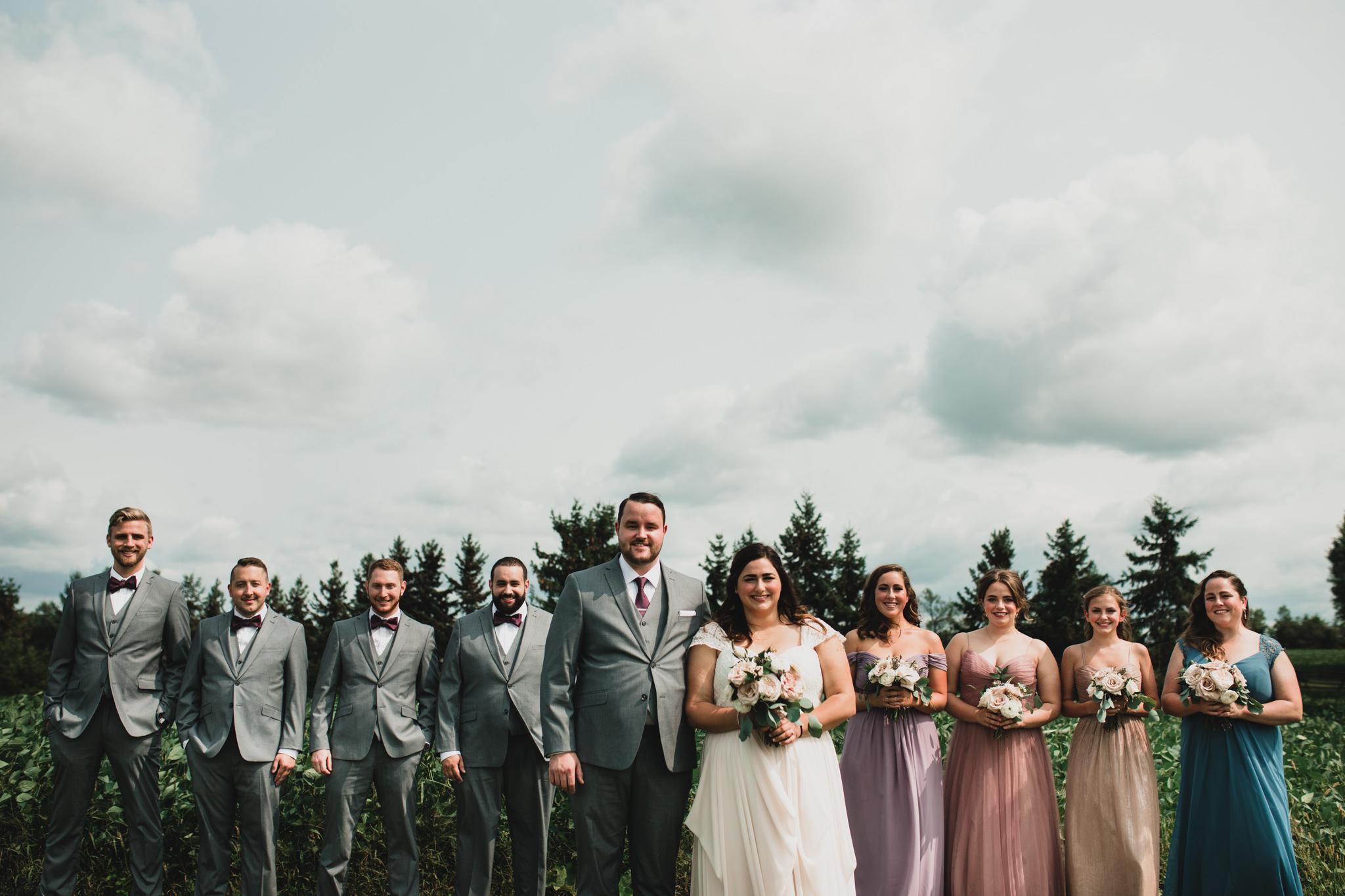 Mixed coloured dresses, bridesmaids