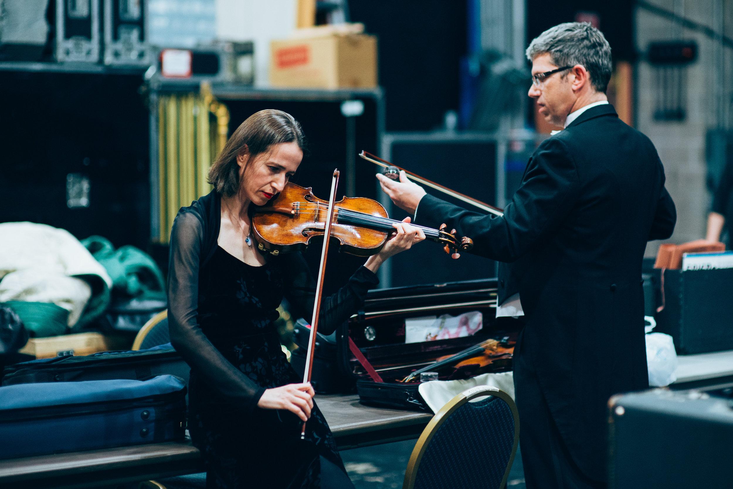 Rossitza Goza, Tulsa Symphony Orchestra Concertmaster practicing backstage