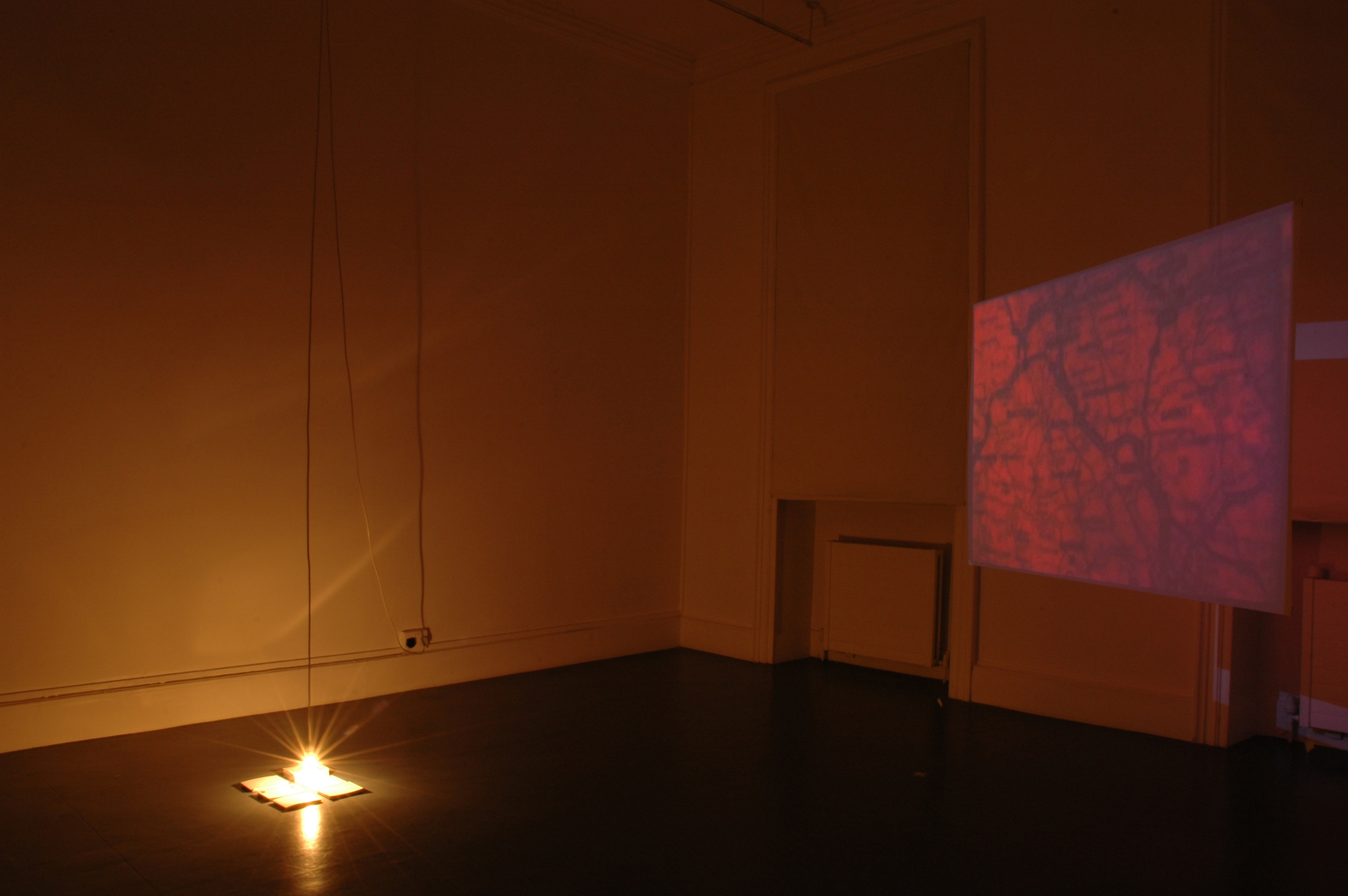Broken Landscape - Installation view - 2006  Projection, postcards, light bulb and cable, variable dimensions. Installation view. Process Room. IMMA