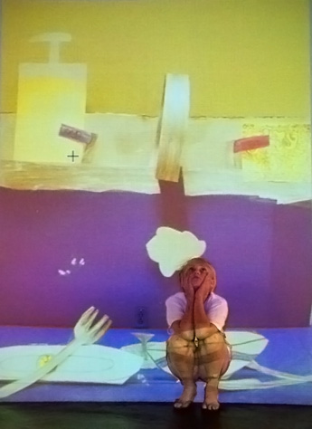"""""""Mini Big World"""": Using drawings, cutouts, cardboard, and paper, kids created dioramas of imagined landscapes that were photographed and projected large-scale onto the wall. They then had a chance to be part of the worlds they created, and were photographed within their scenery. Pictured: Io in her kitchen sink!"""