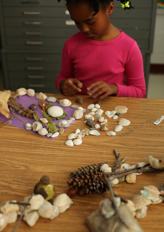 An Art Brains student working on a composition during an Ephemeral Art-making class