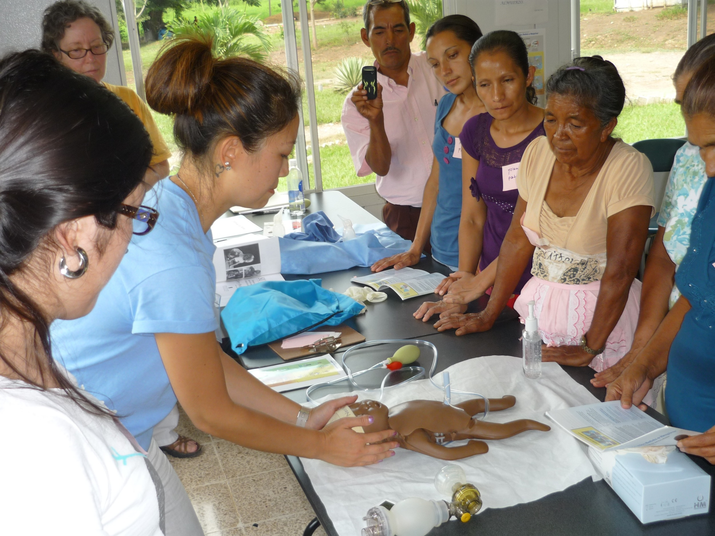 Members of the brigade from Allentown, PA conduct training for midwives from surrounding villages.