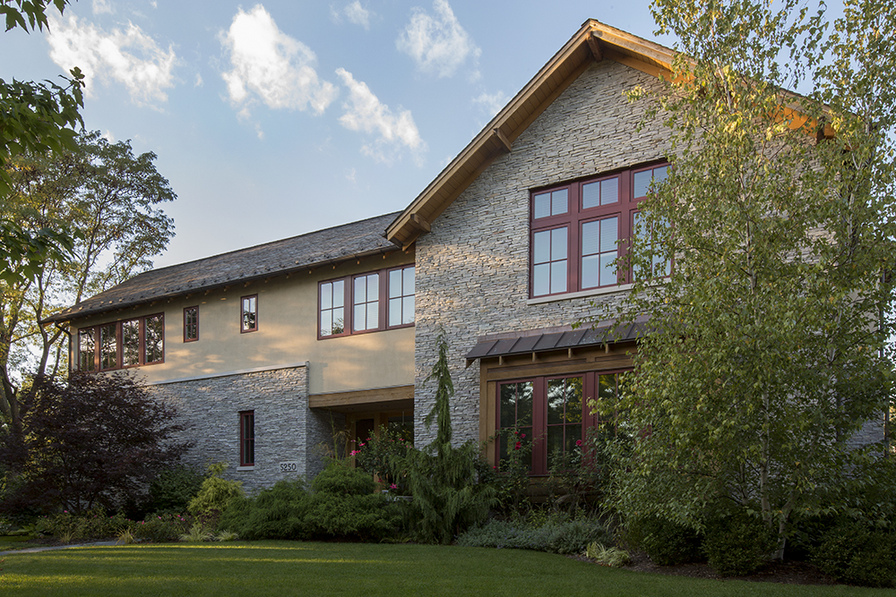 Front Facade - Natural stone, stucco cladding, slate roof and copper gutter and downspouts