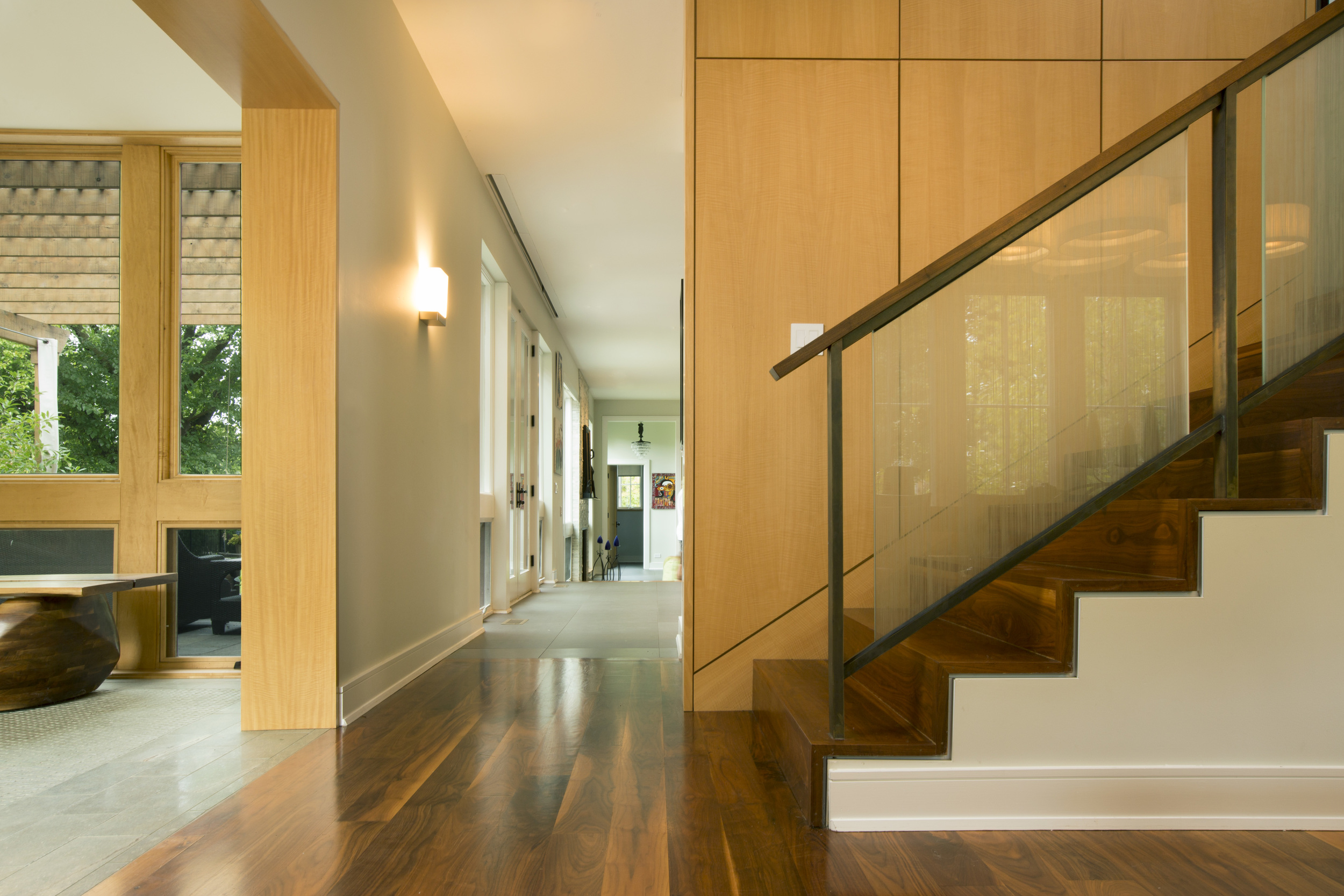 The stair separates the Dining Room from the more informal Kitchen,Family room and informal eating areas