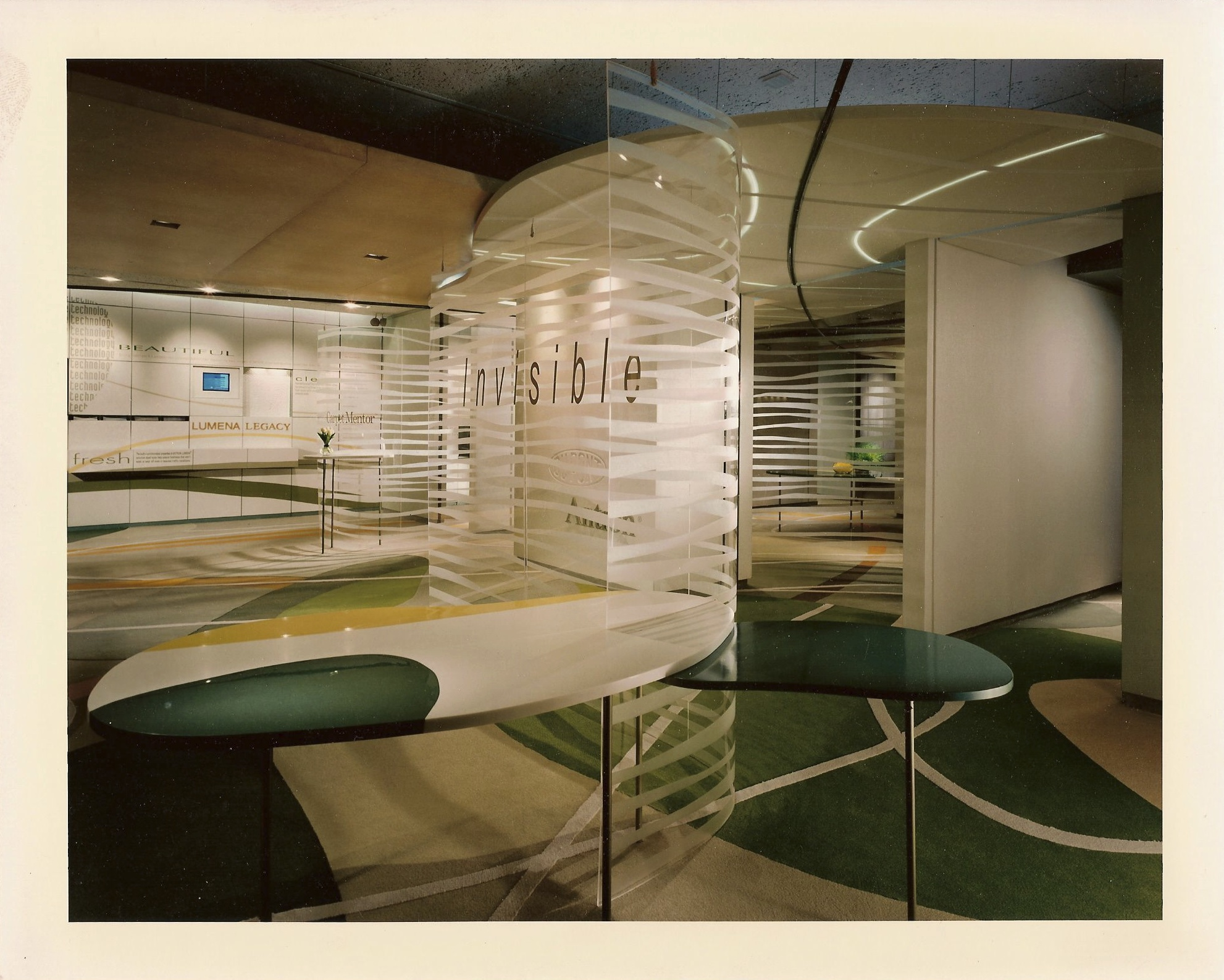 Custom millwork with automotive finishing and Corian inlays, formed acrylic work with applied graphics, and flooring inlays by Ndio.
