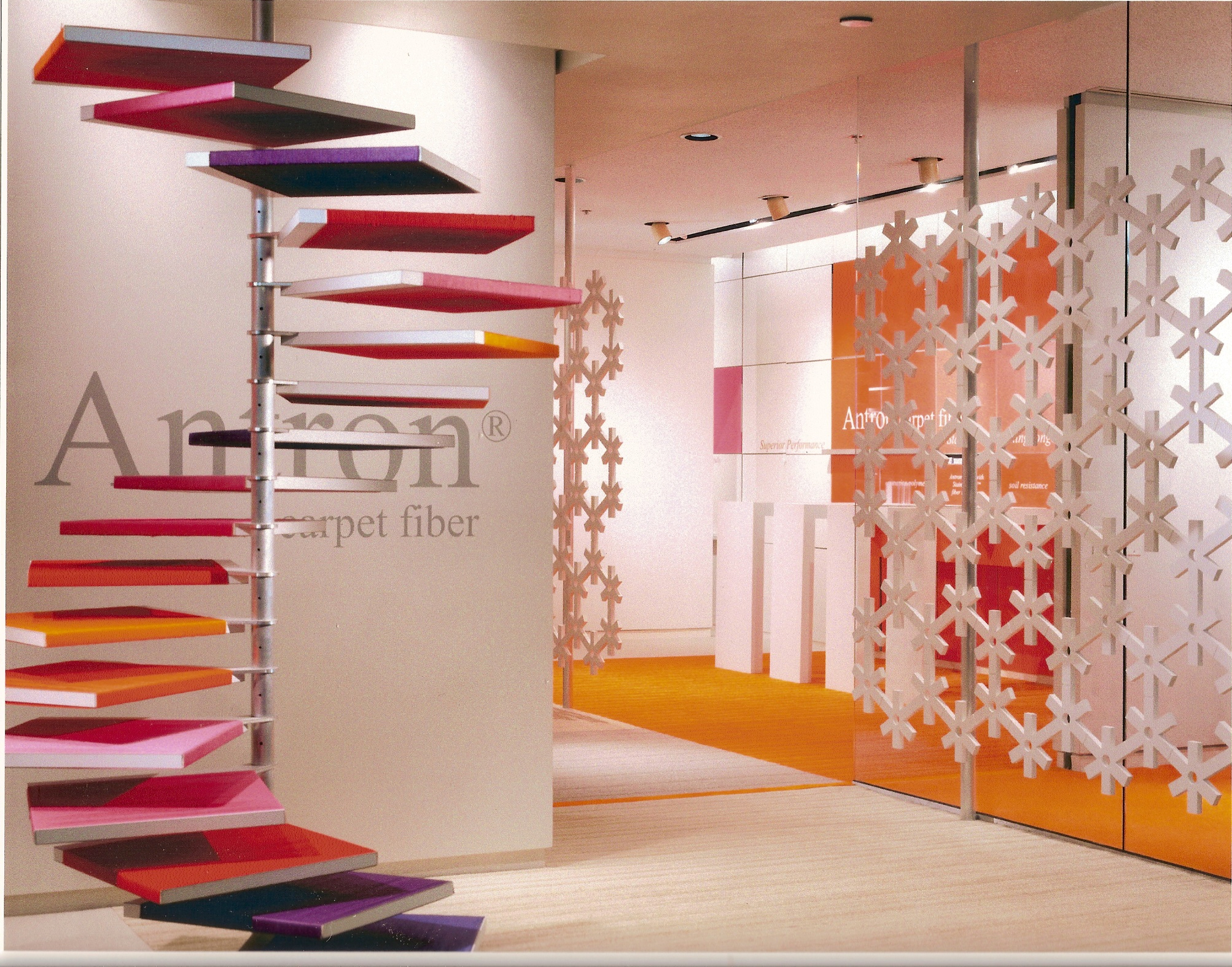 Custom helicoil display with fiber wrappings, CNC-cut retro wall panels, custom-printed graphics, and millwork by Ndio.