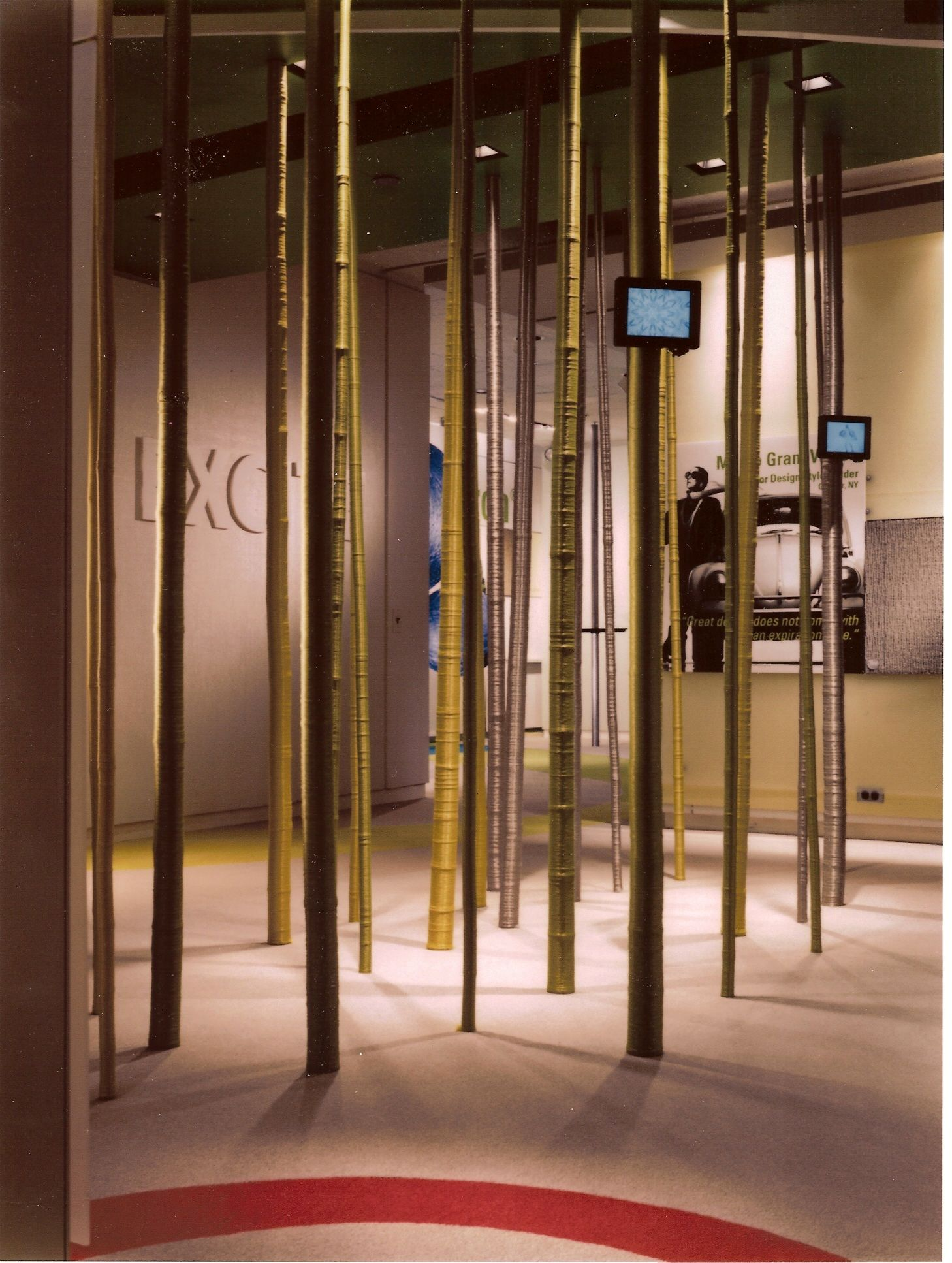 Printed graphics, dimensional copy, fiber-wrapped bamboo poles, and electronics installation by Ndio.