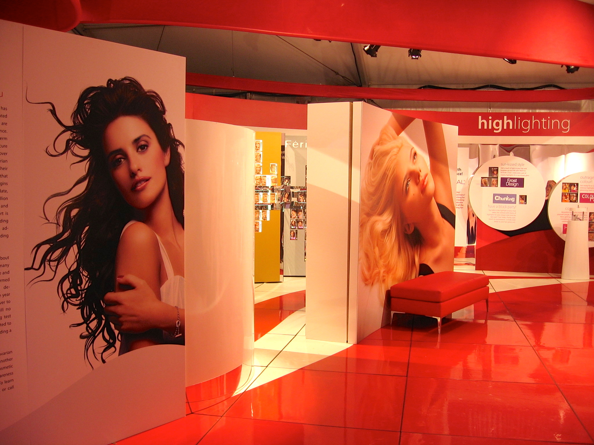 Flooring, tension-fabric shapes, all displays, and photo imaging by Ndio. Design by Legacy Marketing Partners.