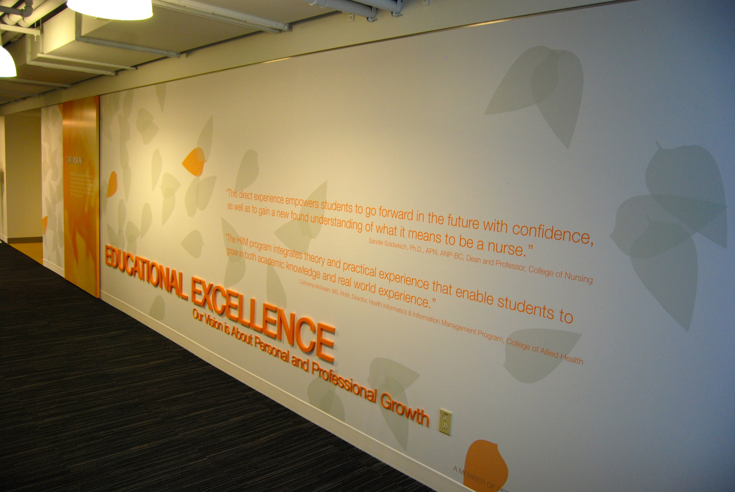 Custom-printed wallcoverings, dimensional panels and lettering, vinyl copy, and installation by Ndio. Design by Perkins+Will.