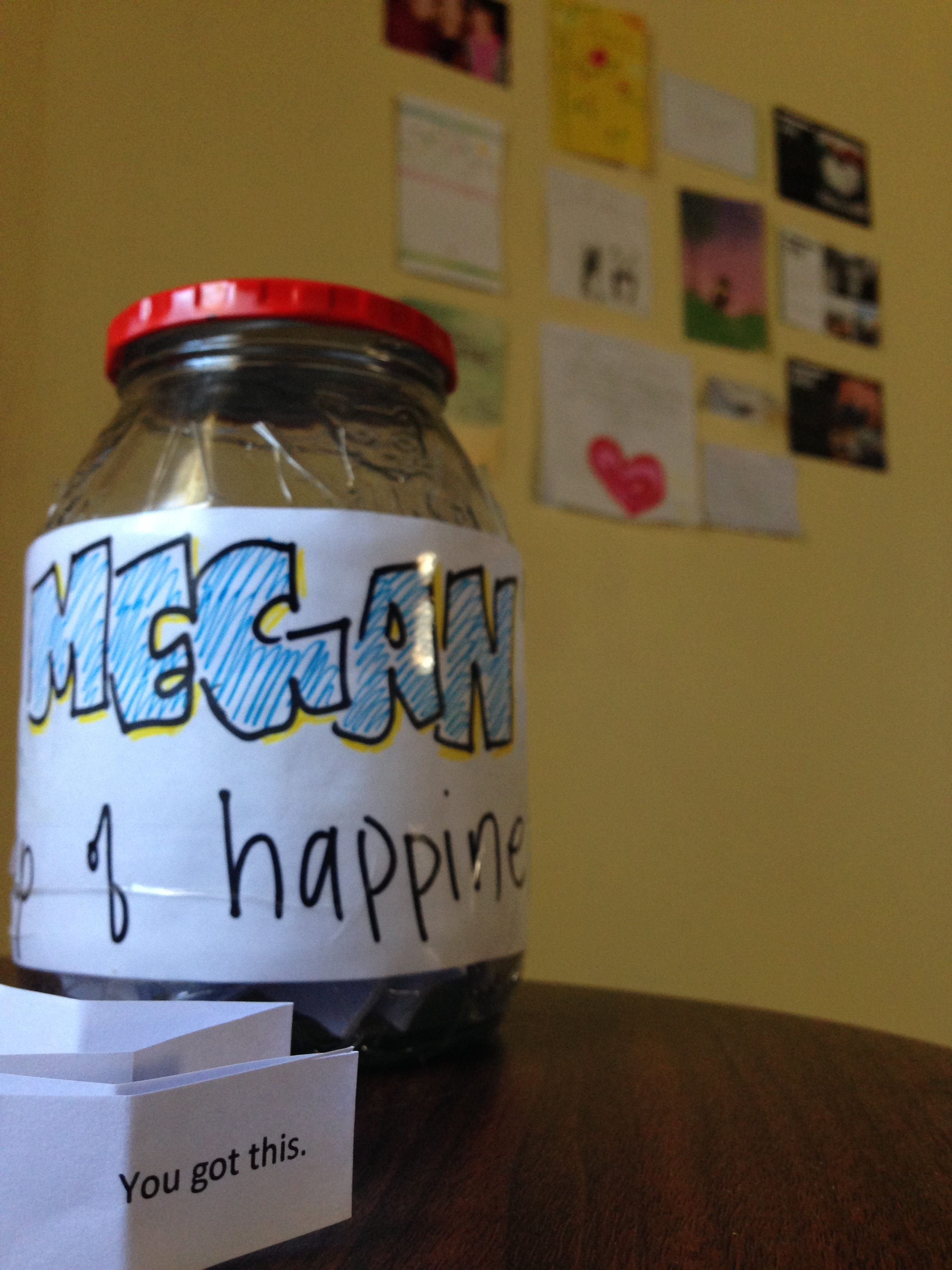"""Generosity  - KwaZulu-Natal, South Africa  This jar, my """"Cup of Happiness,"""" contains affirmations, and was generously gifted to me by a fellow Peace Corps Volunteer. The background, deemed my, """"Wall of Love,"""" is filled with letters, cards and pictures from my beloveds."""