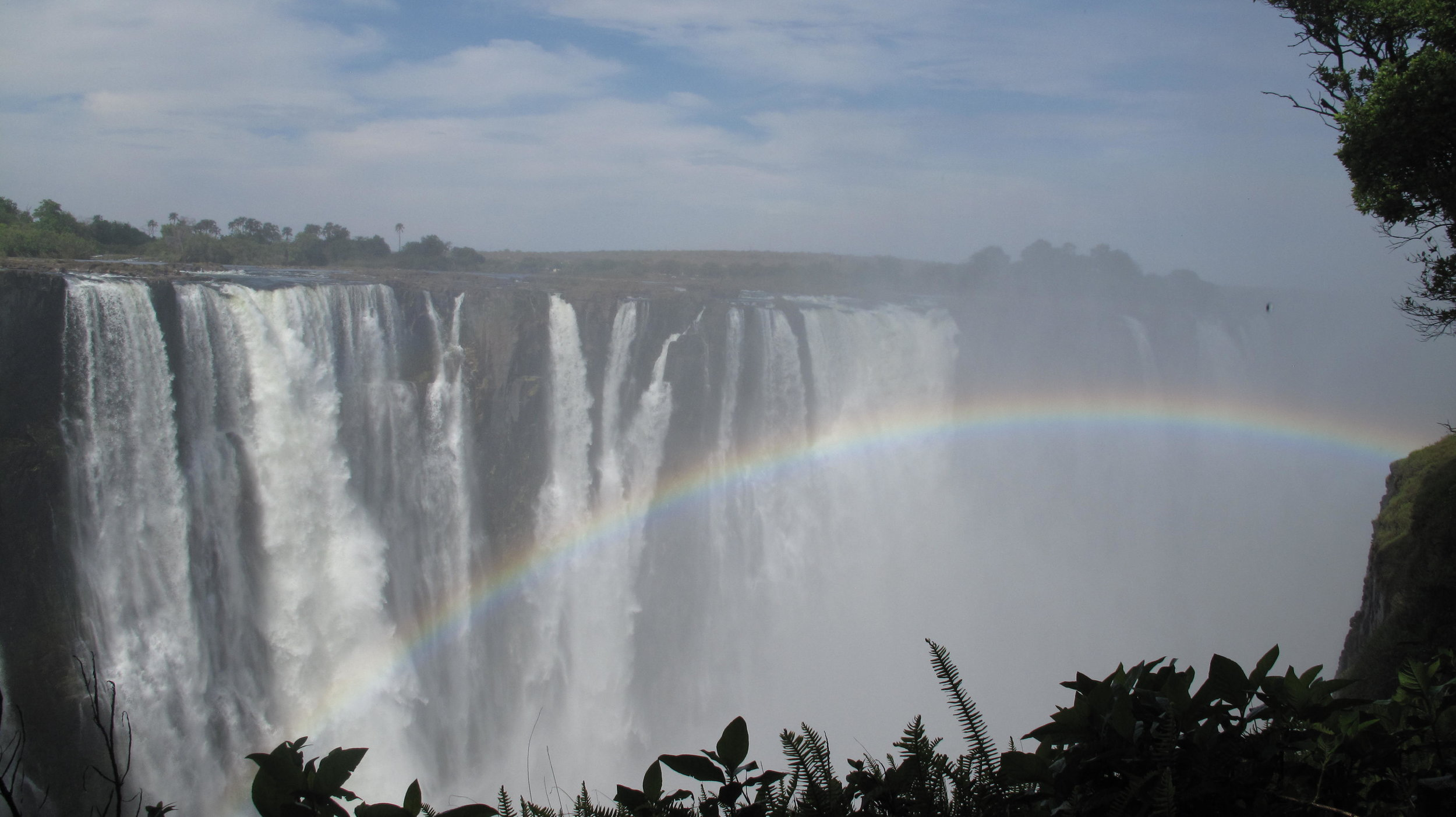 The Other Side:  Connect with the Photo: Taken right at the end of a visit to Victoria Falls. Shot from the Zambia side looking towards Zimbabwe.