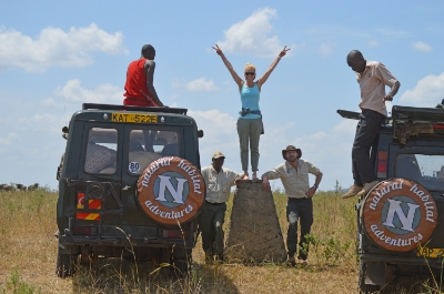Border stone, one foot in Kenya, one foot in Tanzania