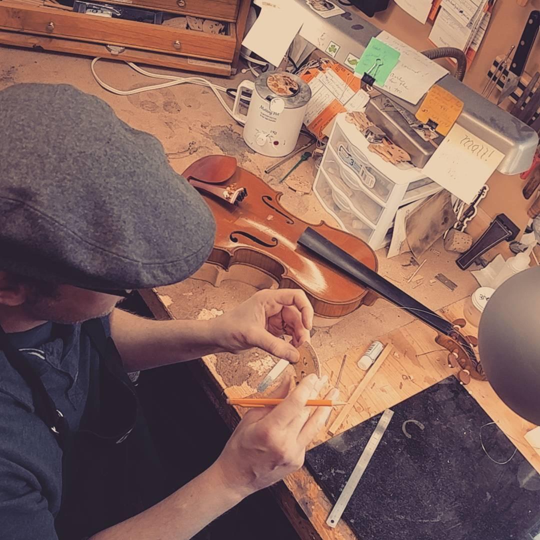 Matt Wyatt fitting a violin bridge