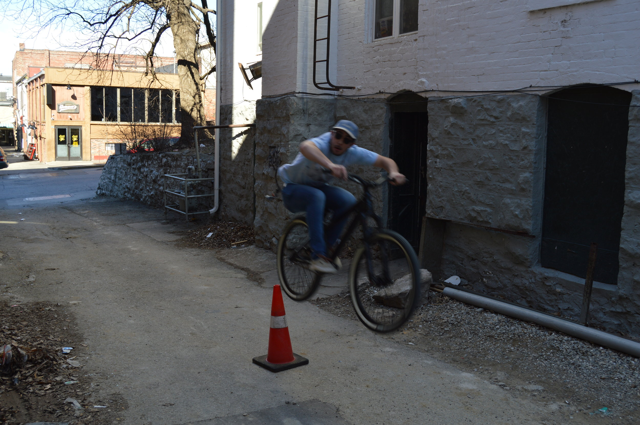 Andrew Sigala jumping around during his Mr. February shoot for the Members of Mizzou Cycling Calendar