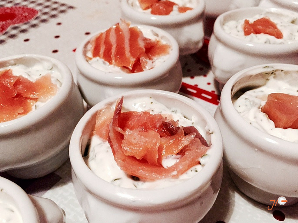 French appetizer with salmon and herb cream
