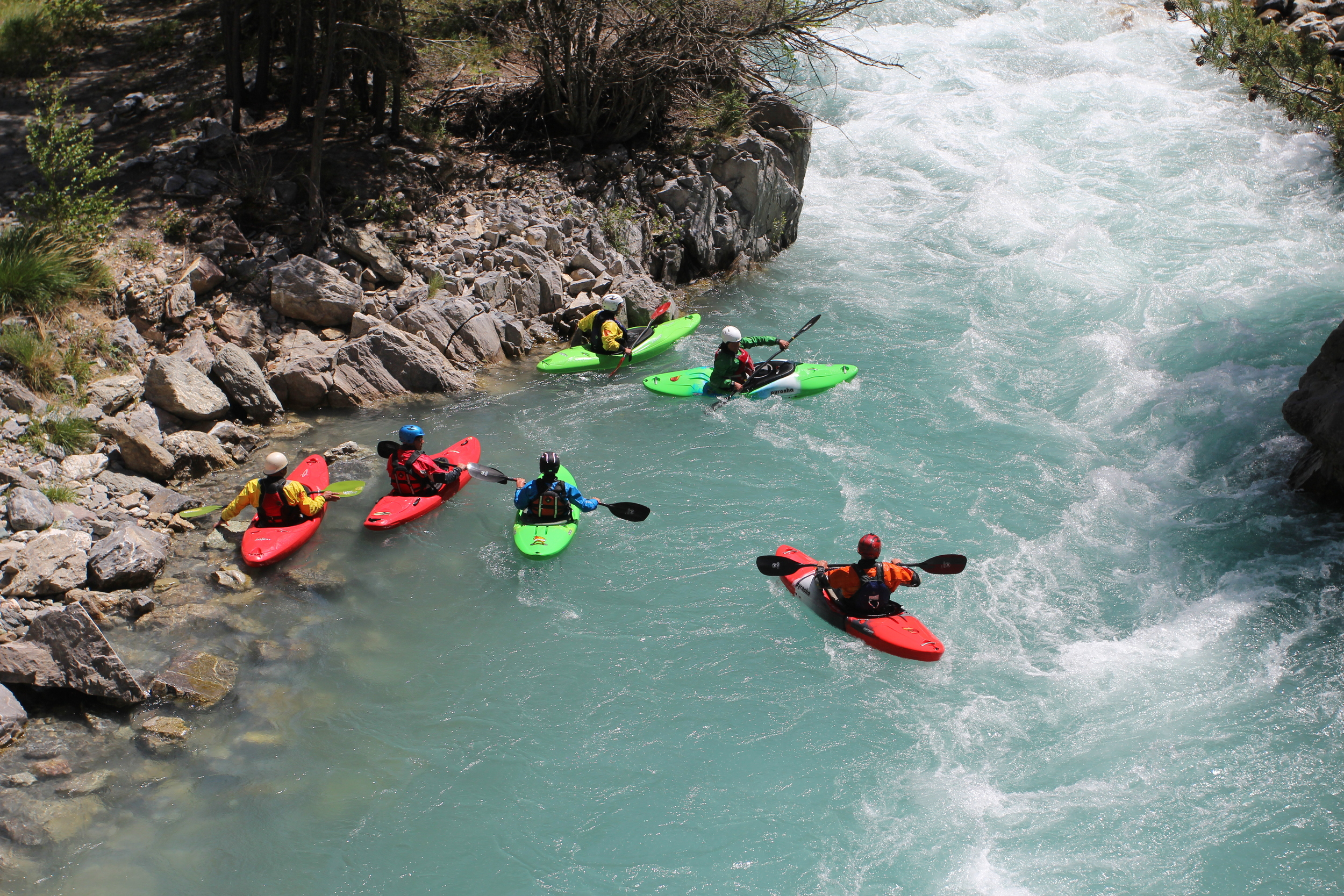 A team of paddlers working together on the River Guil in the French Alps