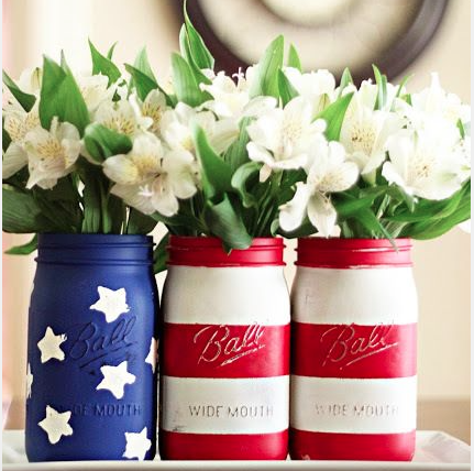 Another DIY! During the day use painted Mason jars to hold flowers, food or decorations. As the night comes to a close, turn the jars into votives and put a tealight candle inside to set the mood.