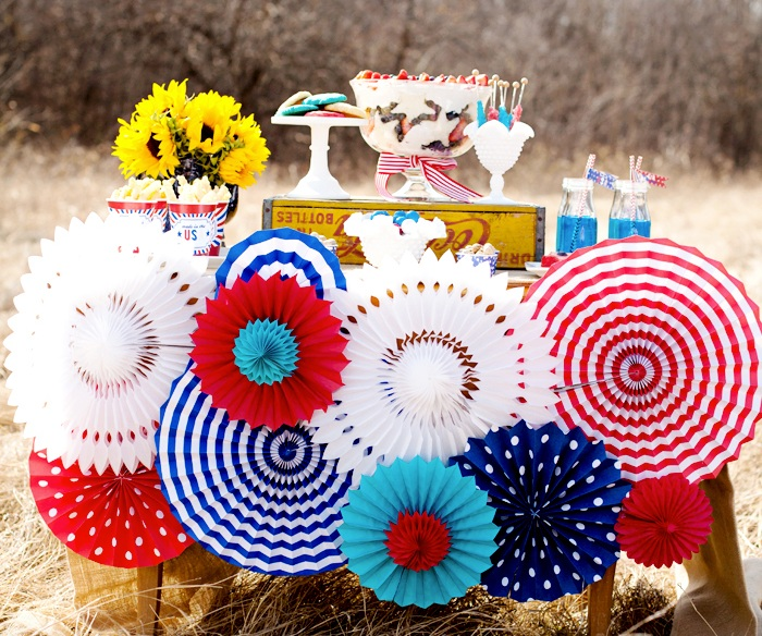 Paper pinwheels, stars and banners are great ways to add excitement and whimsy to any space. Whether you hang them from the ceiling, place them in a table setting or put them in the yard, these fun pops of color liven up all negative spaces. Many of the designs are available in the forms of free printables online!