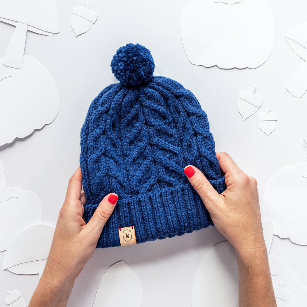 free cable knit hat pattern from Kelbourne Woolens in aran weight yarn.