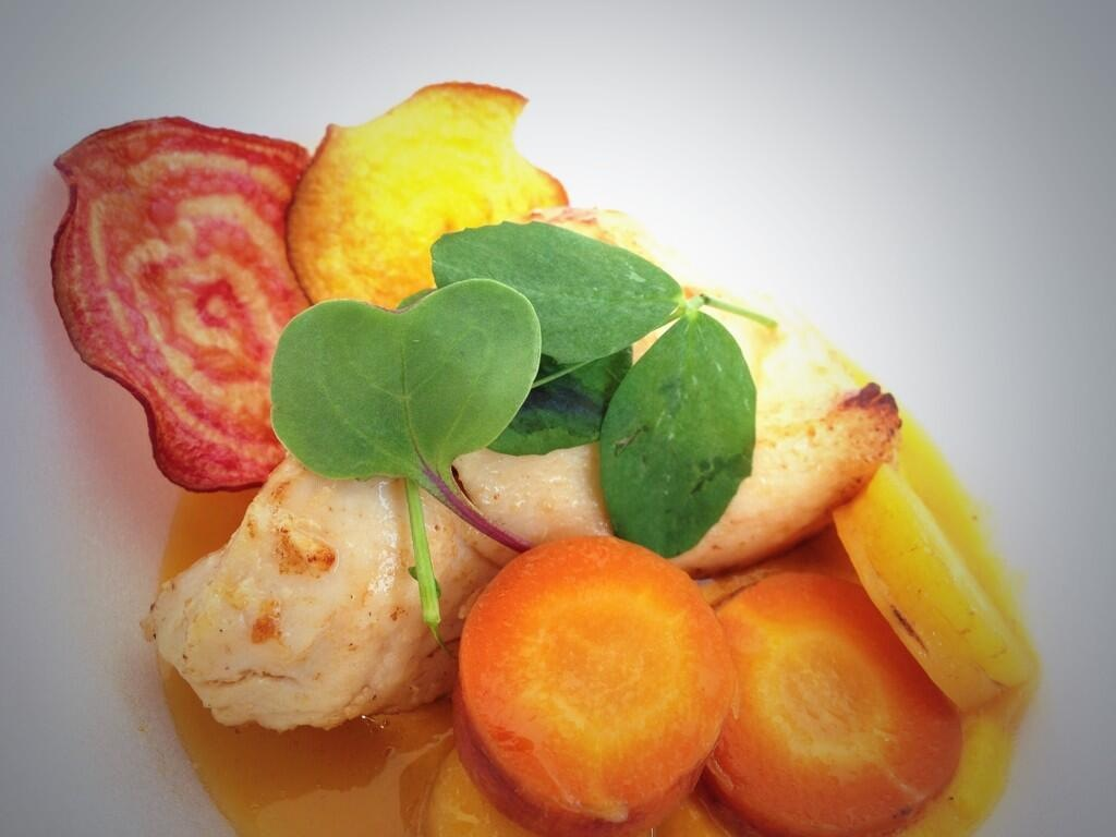 Sous Vide Chicken served with Rainbow Carrots, crisp Beet Chips and an Orange Gastrique