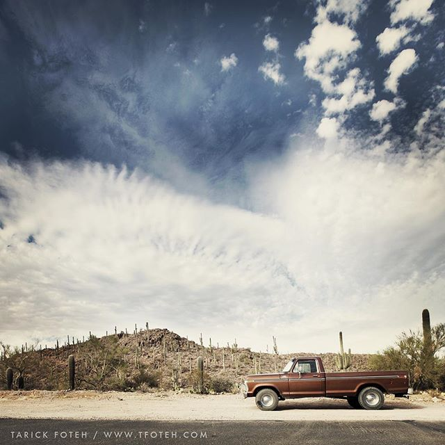 A old #photograph i took of A #classic #ford #f100 parked in the #desert  in #tucson #arizona surrounded by #sand #cactus and #sky shot on a #canon #1dsmark3 with #1635mm f/2.8Lii . . , . , . . #teamcanon #canonbringit #gitzoinspires #teamcanon #canonphotography #clouds  #framedongitzo #landscapephotography #texasphotographer #travelphotography #west #houstonphotographer #fordtrucks #f150 #landscape #mountains