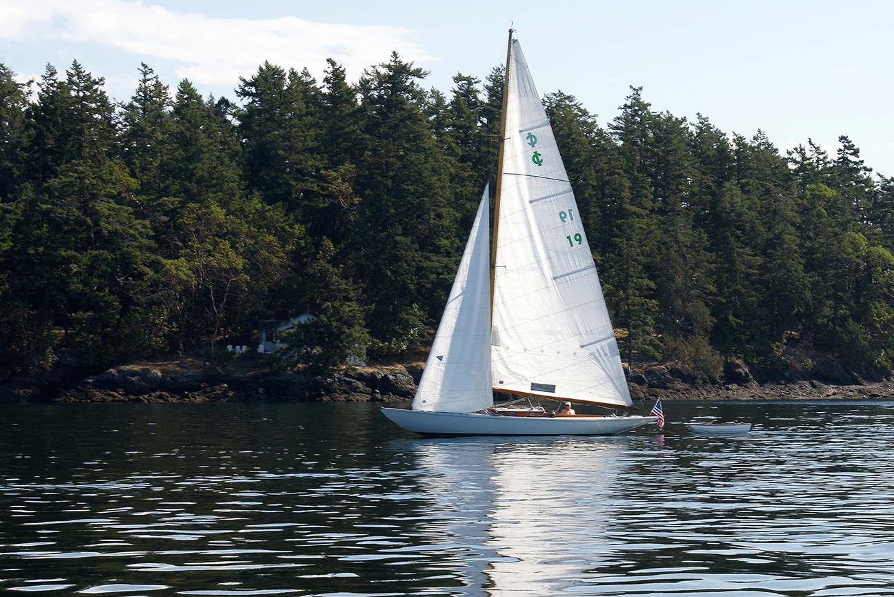 Mike Douglas ghosting in his IC one-design near West Sound