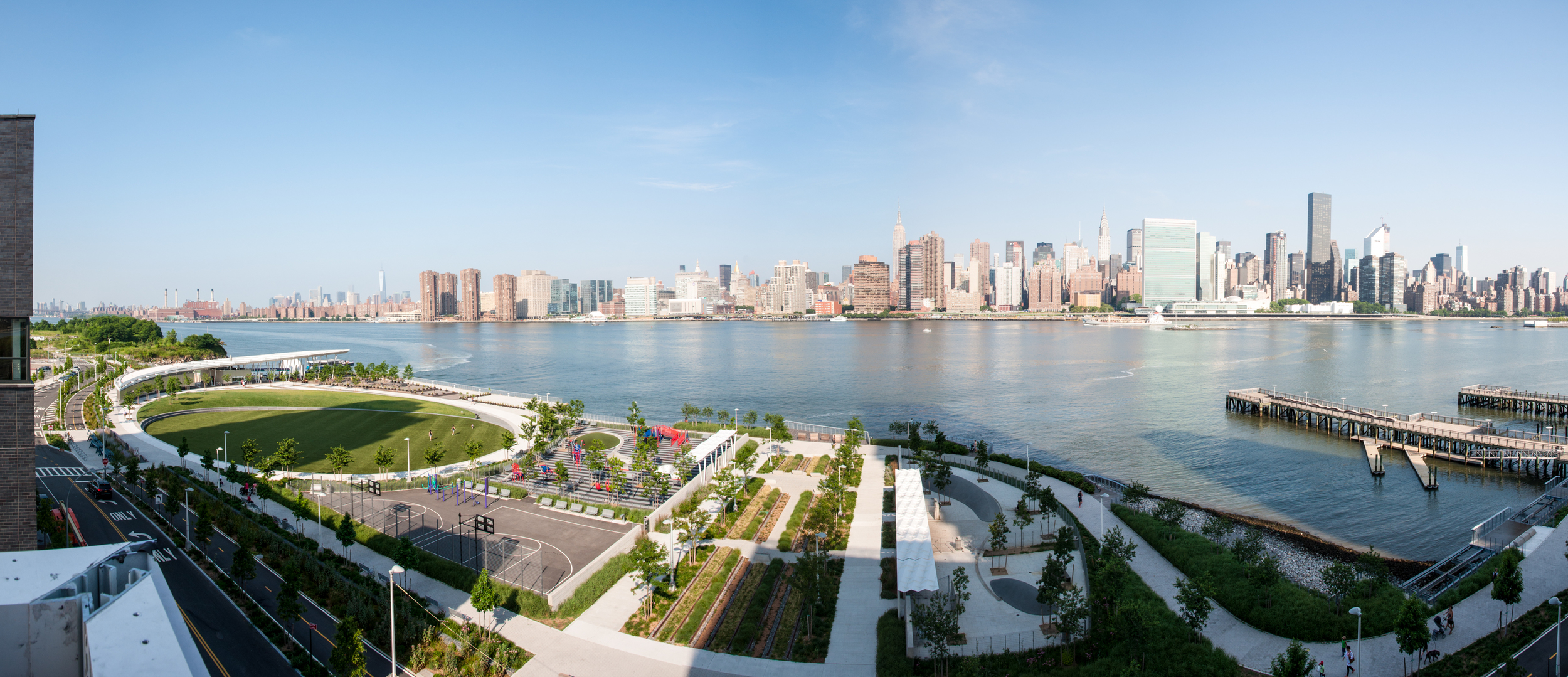 View of Manhattan and Hunters Point South Park from the western terrace of Building A