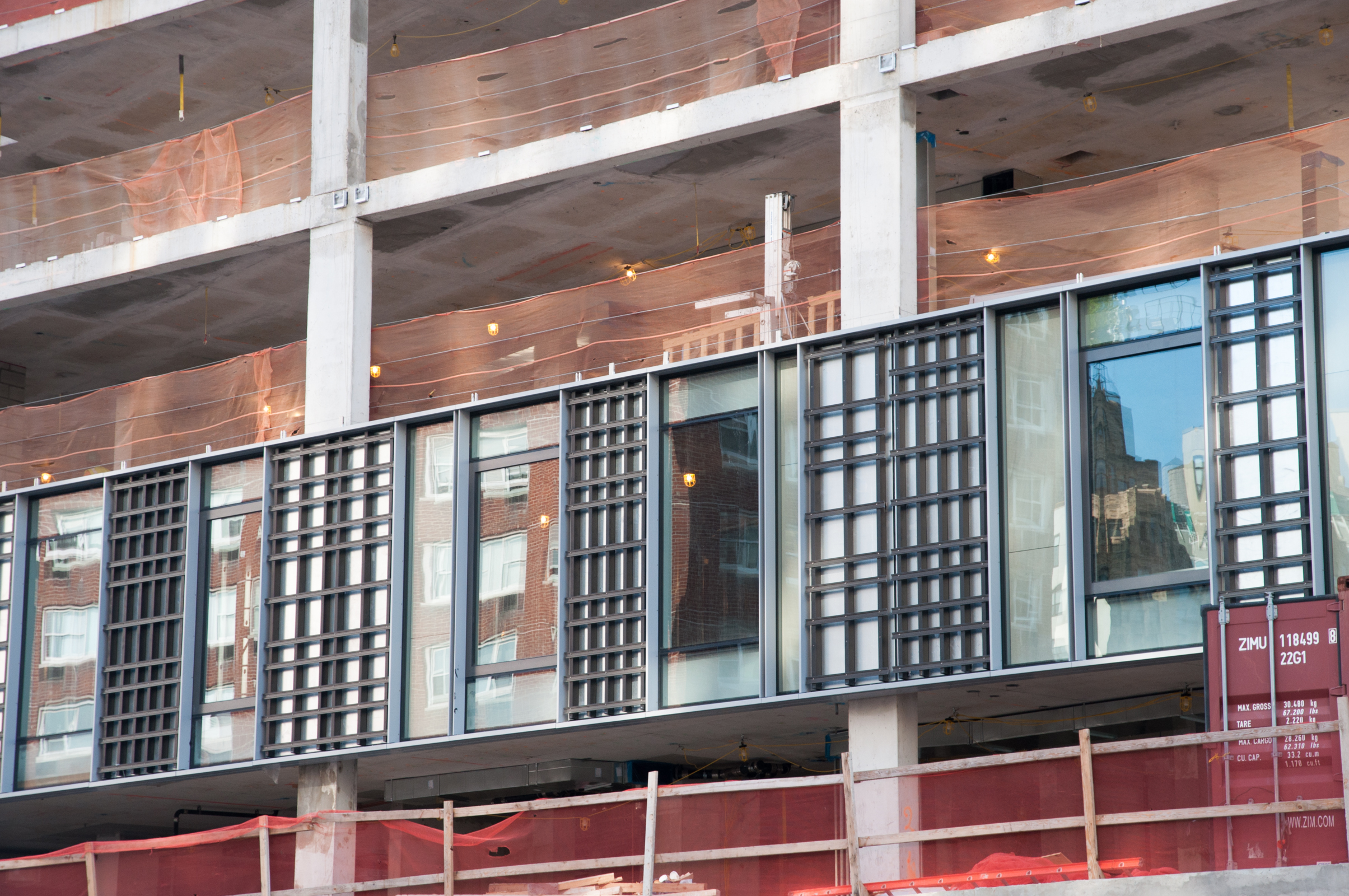 Detail of the curtain wall units with the griddedlimestone panel supports visible.