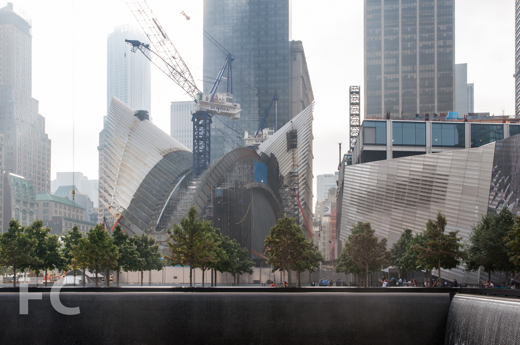 The WTC Transit Hub (center) and WTC Museum (right) seen from the Memorial pools.