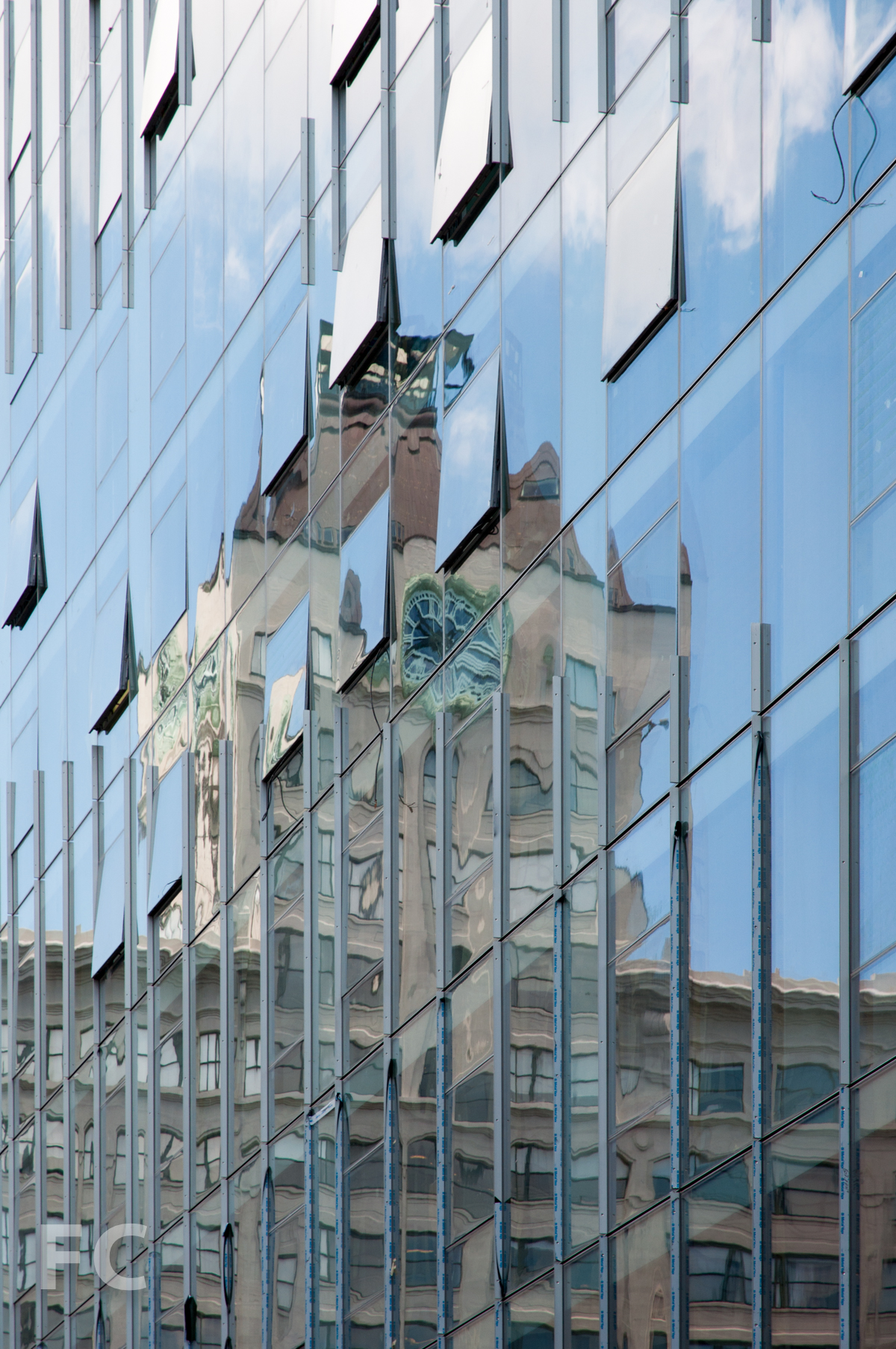 Reflection of the Clock Tower building in the curtain wall.