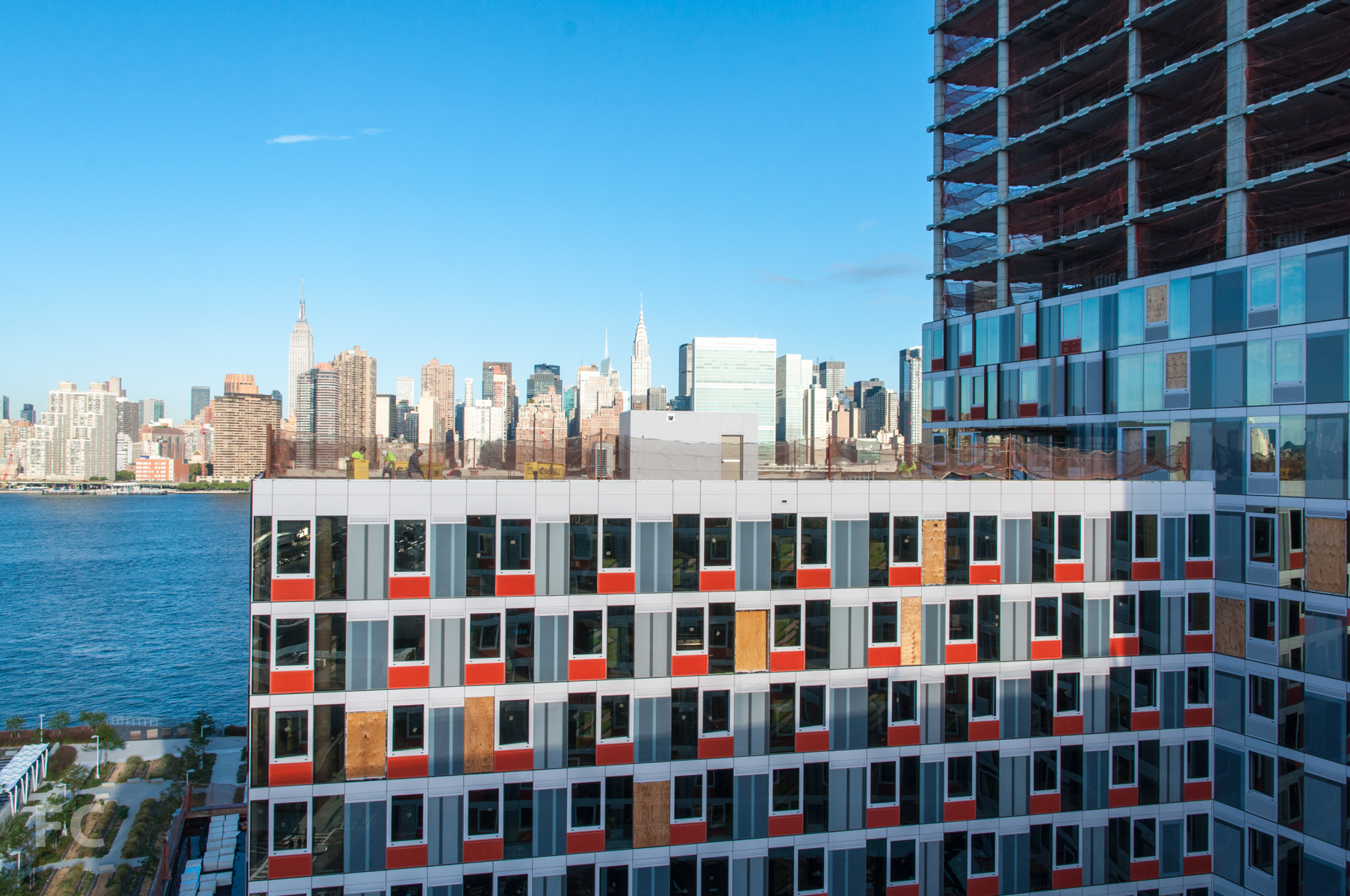 The view of the Manhattan skyline from a lower level roof deck on Building A.
