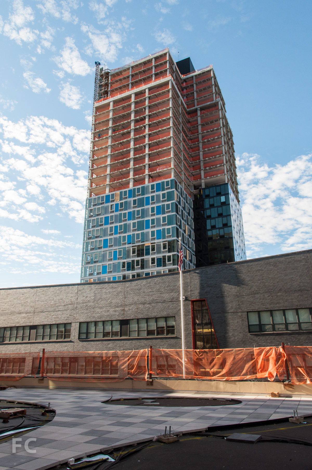 The north façade of Building B from the podium roof deck of Building A.