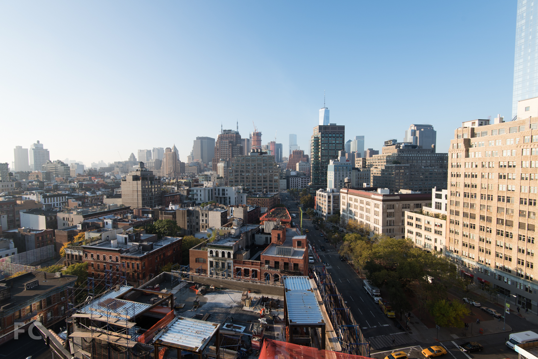 Looking south from the Penthouse A roof terrace, with 166 Avenue of the Americas (foreground) and Tamarkin's 10 Sullivan Street under construction. Construction on 56 Leonard and 30 Park Place is also visible in the distance.