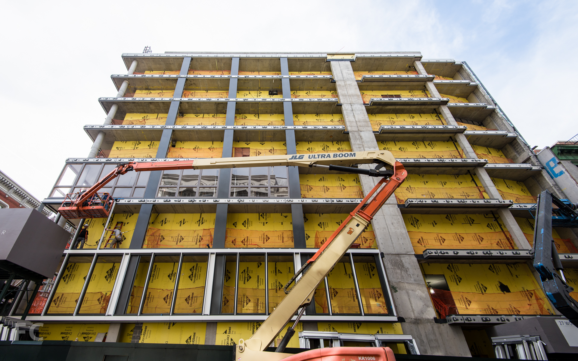 Installation of the facade frame on the north facade.