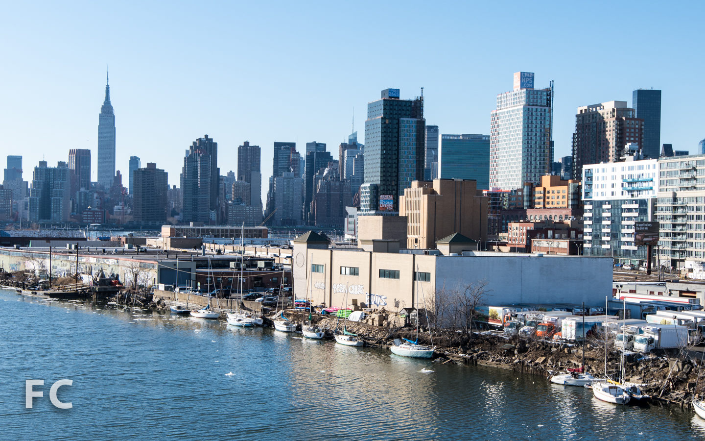 View of Hunters Point South (right) and the Manhattan skyline (left) from the Pulaski Bridge.