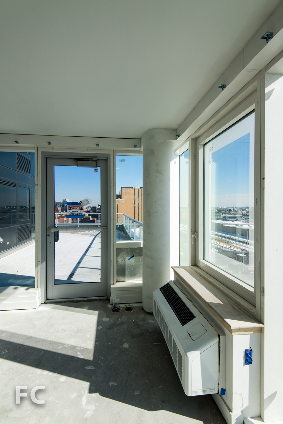 View of the lower terrace from a corner unit in   Hunter's Point South Crossing.