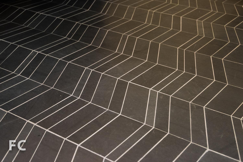 Powder room floor tile.