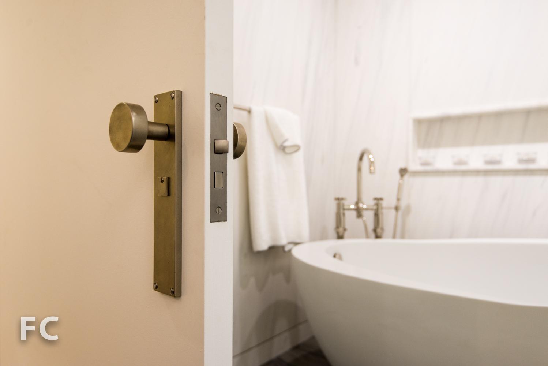 Custom door hardware in the master bathroom.