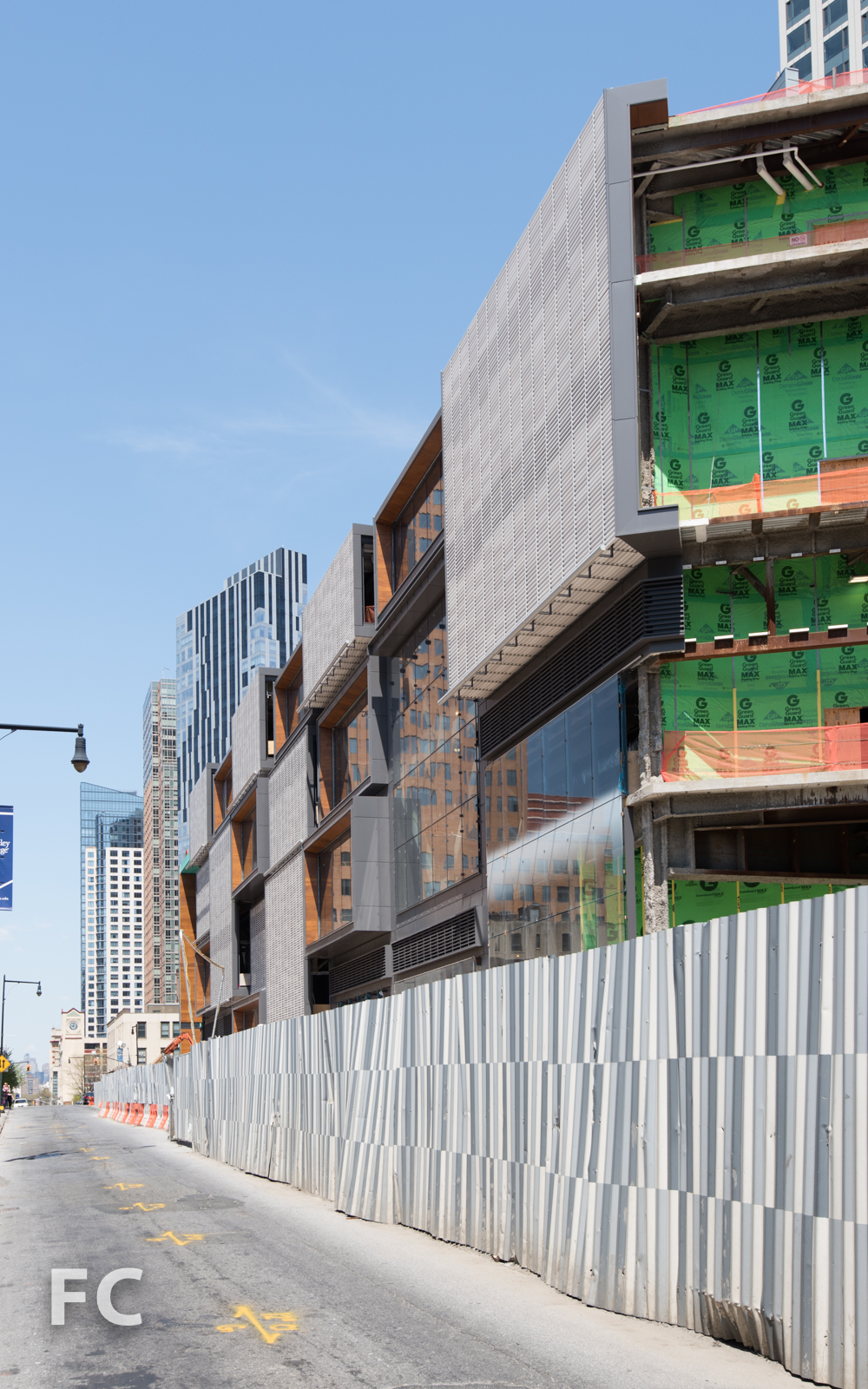 West facade of the Phase Two retail podium from Albee Square West.