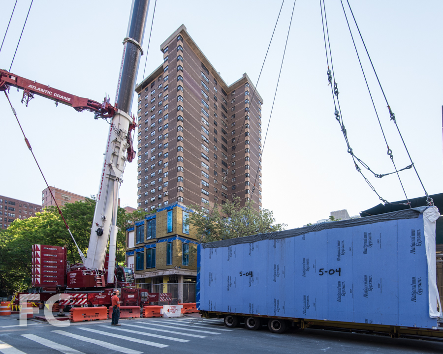 Module on site preparing to be lifted for stacking.